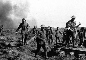 German prisoners help carry wounded British soldiers back to their trenches after an attack near Ginchy, France, during the Battle of the Somme in 1916.