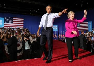 President Obama joins Hillary Clinton on the campaign trail for the first time this year at a rally in Charlotte, N.C., on Tuesday.