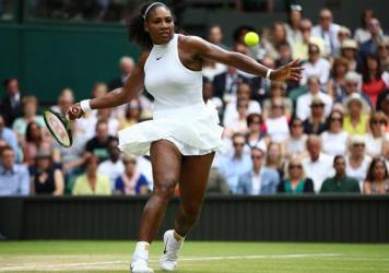Serena Williams of The United States plays a forehand during The Ladies Singles Final against Angelique Kerber of Germany on day twelve of the Wimbledon Lawn Tennis Championships at the All England Lawn Tennis and Croquet Club on July 9, 2016 in London, England.