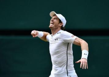 Britain's Andy Murray celebrates beating Canada's Milos Raonic during the men's singles final match on the last day of the 2016 Wimbledon Championships in Wimbledon, southwest London, on Sunday.