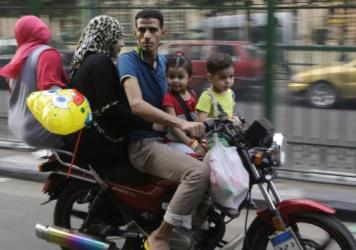An Egyptian family squeezes onto a motorbike in Cairo in this 2014 photo. After falling for decades, the country's birthrate has been rising in recent years. Egypt now has more than 90 million people, more than twice as many as any other Arab nation.