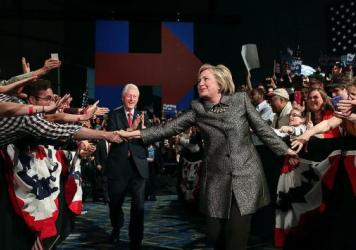 Democratic presidential candidate Hillary Clinton and former U.S. president Bill Clinton greet supporters during a primary night gathering on April 26 in Philadelphia, where Clinton will return for the Democratic National Convention later this month.