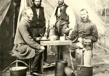 """Nobody can soldier without coffee,"" a Union soldier wrote in 1865. (Above) Union soldiers sit with their coffee in tin cups, their hard-tack, and a kettle at their feet."