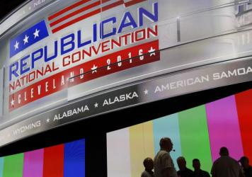People gather onstage July 16 as preparations take place inside Quicken Loans Arena for the Republican National Convention in Cleveland, Ohio. The convention is set to run July 18-21.