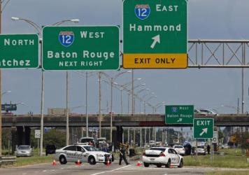 Baton Rouge police block Airline Highway after police were shot in Baton Rouge, La., Sunday, July 17, 2016. Authorities in Louisiana say several law enforcement officers are dead, and several injured in Baton Rouge after on-duty law enforcement officers were shot on Sunday morning.