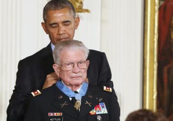 "President Obama presents the Medal of Honor to retired Army Lt. Col. Charles Kettles for bravery during the Vietnam War. Obama said acknowledging Kettles was a gift for the nation following ""a couple of tough weeks."""