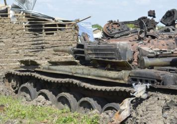 Tanks destroyed in recent fighting are seen near South Sudan's capital of Juba. The African Union has approved a plan to put a regional force in the country.