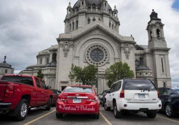 "A car with ""#Justice4Philando"" written on it is parked outside the funeral of Philando Castile at the Cathedral of St. Paul."