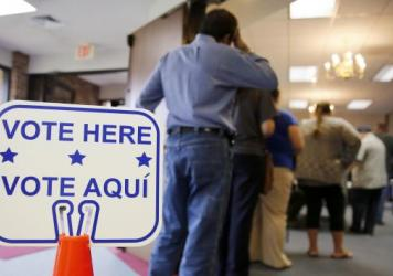 Voters stand in line to cast their ballots inside Calvary Baptist Church in Rosenberg, Texas, on March 1, during the primaries.