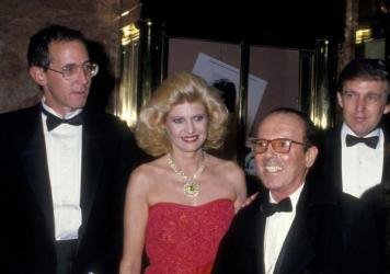 Tony Schwartz (from left), Ivana Trump, photographer Francesco Scavullo and Donald Trump celebrate the publication of Donald Trump's 1987 book, <em>The Art of the Deal,</em> which was ghostwritten by Schwartz.