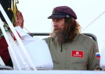 Fedor Konyukhov waves to spectators before lift off from the Northam Aero Club on July 12 in Northam, Australia.