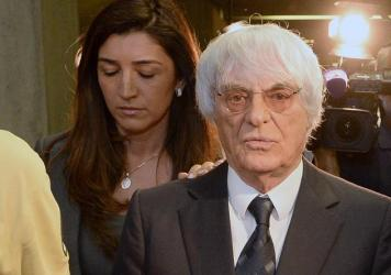 The mother of Fabiana Flosi, seen here with her husband, Formula One racing chief Bernie Ecclestone, has reportedly been kidnapped in Brazil. Flosi and Ecclestone are seen here in 2014, after a court proceeding in Germany.