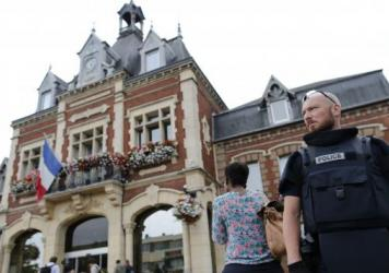 French soldiers stand guard near the scene of an attack in Saint-Etienne-du-Rouvray, Normandy, France, on Tuesday.
