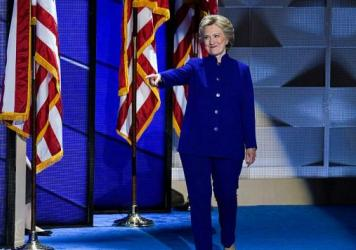 Democratic presidential nominee Hillary Clinton takes the stage at the Democratic National Convention in Philadelphia Wednesday night following President Obama's speech.