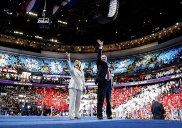 Democratic presidential candidate Hillary Clinton and Democratic vice presidential candidate, Sen. Tim Kaine, wave to members of the audience as they stand on stage during the fourth day session of the Democratic National Convention.