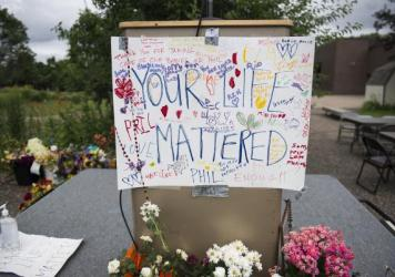 "A sign reading ""Your Life Mattered"" hangs on a lectern outside J.J. Hill Montessori School in St. Paul, Minn., on July 14, following a funeral service for Philando Castile at the Cathedral of St. Paul. Castile, who was a cafeteria manager at the school, was shot and killed by police on July 6."