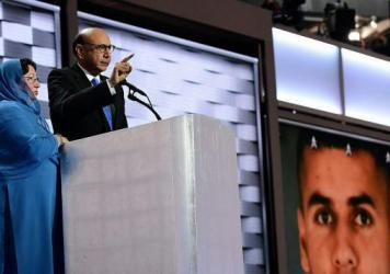 Khizr, whose son was killed in Iraq, speaks directly to Donald Trump at the Democratic National Convention in Philadelphia on July 28. His wife Ghazala Khan stands beside him.