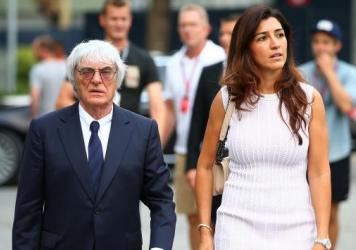 Formula One boss Bernie Ecclestone walks with his wife, Fabiana Flosi, in Singapore in 2014. Flosi's mother was kidnapped in Brazil and held for ransom last month; she's now been freed, police say.
