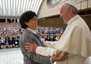 Pope Francis hugs Sister Carmen Sammut at the end of a meeting in May with hundreds of women who serve the Roman Catholic Church. The pontiff has appointed a commission to study whether women can serve as deacons.