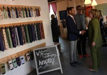 Democratic presidential nominee Hillary Clinton visits the Knotty Tie Company Wednesday in Denver, Colo.