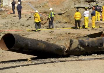A natural gas line lies broken in San Bruno, Calif., after a massive explosion on September 9, 2010. A federal jury found Pacific Gas & Electric Co., California's largest utility, guilty of misleading investigators about how it was identifying high-risk pipelines.