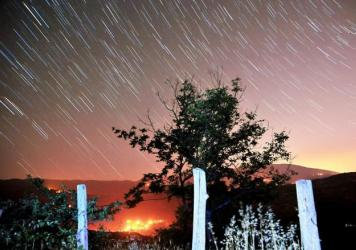 Perseid meteors streak across the sky over the city of Inegol in Turkey's Bursa Province in August 2015.