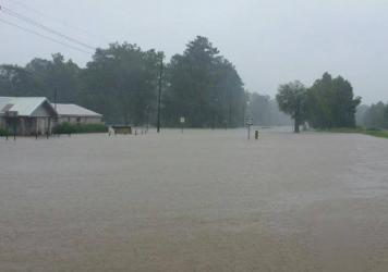 Flooding on U.S. 51 in the Village of Tangipahoa, La. Heavy rains have caused rivers to crest in Louisiana and neighboring Mississippi, closing schools and roads and stranding residents.