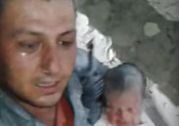 Syrian Civil Defense Force rescuer Khaled Omar Harrah after pulling a baby from a destroyed home in Aleppo. The moment was caught on video and gained international attention.
