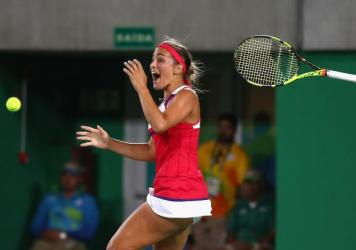 Monica Puig of Puerto Rico reacts after defeating Angelique Kerber of Germany in the women's singles gold medal match at the Rio Summer Olympics.