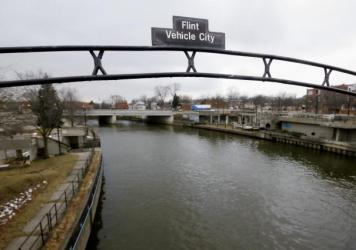 A sign over the Flint River in Flint, Mich. in January 2016.