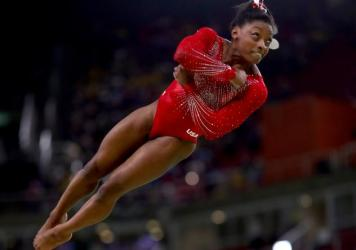Simone Biles won the women's vault final in the Rio Olympic Arena, setting a new mark for wins in a single Olympics by an American woman.