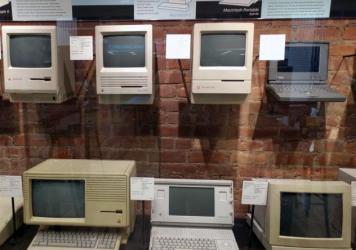 Old Macs are displayed in glass cases in the back of Tekserve, a repair shop with a cult following that's closing this week.