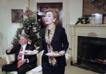First lady Hillary Clinton offers cookies to the Arkansas press corps during an interview with President Bill Clinton in the Roosevelt Room at the White House in 1993.