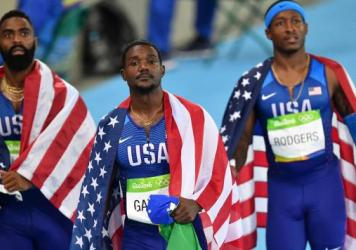Men's 4x100m relay teammates Tyson Gay, Justin Gatlin and Michael Rodgers react after being disqualified from the race at the Olympic Stadium in Rio de Janeiro Friday.