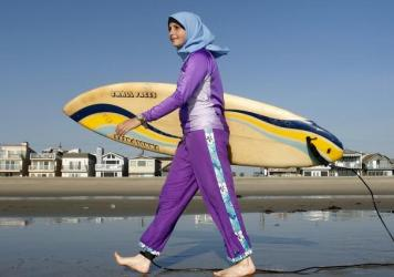 Sama Wareh walks along a California beach in swimwear designed for Muslim women. The photo is from 2007.