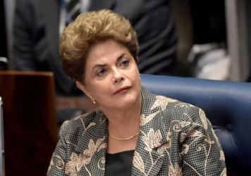 Suspended Brazilian President Dilma Rousseff gestures before delivering a speech in her defense at the National Congress in Brasilia on Monday.