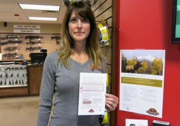 "Jacquelyn Clark, co-owner of Bristlecone Shooting, Training and Retail Center in Lakewood, Colo., holds a list of gun safety rules. One recommendation: Consider ""off-site storage if a family member may be suicidal."""