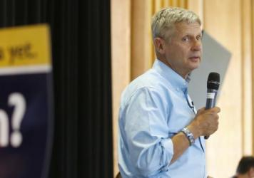 Libertarian presidential candidate Gary Johnson talks to a crowd of supporters at a rally last month in Salt Lake City.