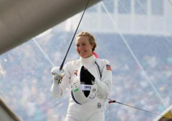 "American Margaux Isaksen smiles during the women's fencing in the Modern Pentathlon on Aug. 19 at the Rio Olympics. She finished fourth in London in 2012 and 20th in Rio. ""It makes you feel sort of worthless,"" Isaksen says of her performance. She calls this current period a ""post-Olympic depression."""