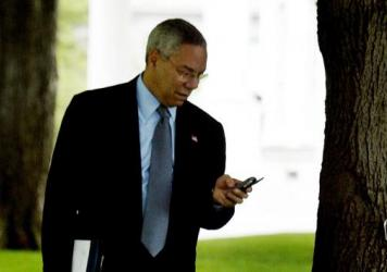 Then-Secretary of State Colin Powell finishes up a call outside the White House in 2002.