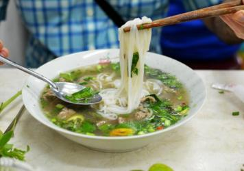 A bowl of pho, a beef and noodle soup, served in Ho Chi Minh City, formerly Saigon. Pho has a rich role in Vietnamese, Vietnamese-American, and now, American culture.