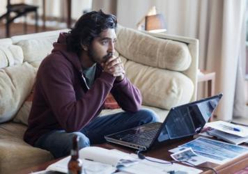 Saroo (Dev Patel) searches for his mother in <em>Lion</em>.