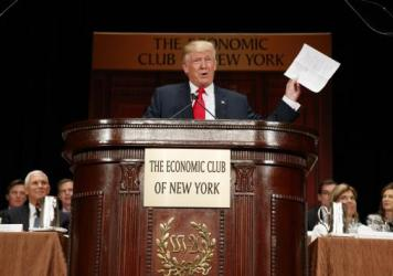 Donald Trump holds up notes as he speaks to the Economic Club of New York on Thursday.