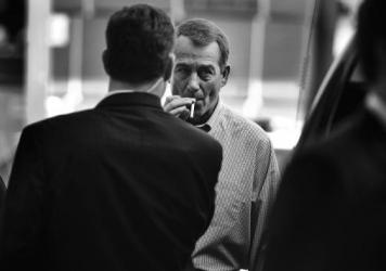 John Boehner smokes a cigarette after a news conference outside of Tart Lumber Company in Sterling, Va., in 2010.