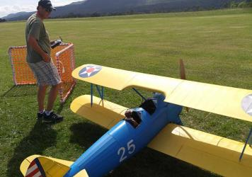 Mike Pecue prepares to send his biplane into the sky over Westport, N.Y.