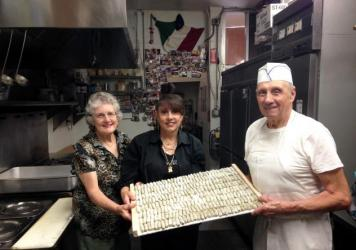 Mary Cittoni, Joanne Cittoni Gonzalez and Clemente Cittoni work together, making malfatti in the kitchen of Val's Liquor in Napa.