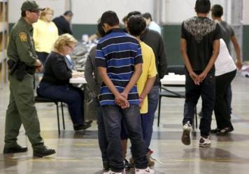 Central American immigrant children are being processed at the U.S. Customs and Border Protection officials in Nogales, Ariz. The Ninth Circuit Court of Appeals ruled that such children may not file a class action lawsuit arguing for government-provided lawyers in deportation hearings.