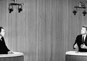 Sen. John F. Kennedy, right, speaks while Vice President Richard Nixon listens during the fourth presidential debate in New York on Oct. 21, 1960. The first general election debates were held that year.