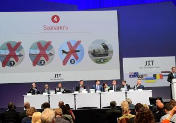 Members of a joint investigation team present the preliminary results of the criminal investigation into the downing of Malaysia Airlines Flight 17 in 2014. The investigators said Wednesday they have confirmed that MH17 was shot down by a Buk missile fired from rebel-held areas in Ukraine.