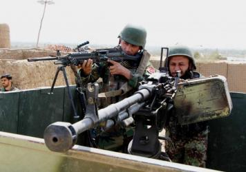 Afghan soldiers fight Taliban militants in Kunduz province, Afghanistan, on Sept. 21.
